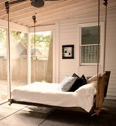 "Constructed of 2-by-4's and 2-by-6's, the full-size bed, supported by hemp rope and custom brackets, can hold up to 1,000 pounds. Berger, who blogs about the Southern way of life at Sweet Peach says, ""I encourage the idea of sleeping porches … to sway and daydream. It's good for the soul."""