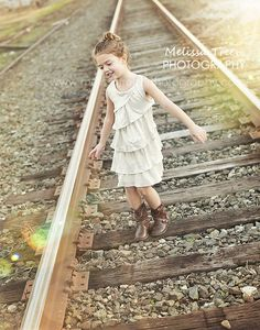 fun childrens photographer, railroad tracks, cowboy boots, modern urban photos in downtown stokesdale nc | summerfield family photography famili photo, railroad track