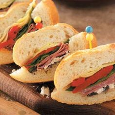 Italian-Style Antipasto Baguette Sandwiches - Refrigerate for at least 3 hours or overnight.  Serve cold, or place foil-wrapped loaves on a baking sheet and bake at 350° for 20-25 minutes or until heated through. Cut into slices; secure with a toothpick. Yield: 3 dozen.    Editor's Note: 1/3 cup purchased tapenade (olive paste) may be substituted for the olive mixture.
