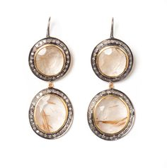 The Woods Fine Jewelry.  I love rutilated quartz, especially with copper, or gold rutiles.