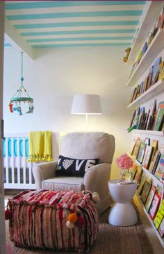 i like the white walls with the books and accessories being colorful