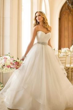 Wedding dress idea! This wedding dress is so pretty! I love how she has the diamond belt around her waist:)