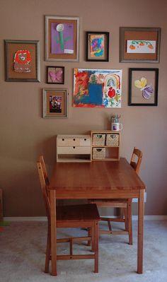 kids table and framed artwork