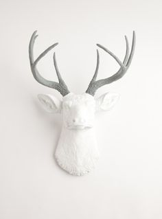 Fake Deer Head - The Helena - White W/ Gray Antlers Resin Deer Head- Stag Resin White Faux Taxidermy. $119.99, via Etsy.
