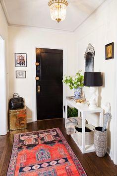 the doors, black doors, abod, persian rug interior, white walls, front doors, entrance halls, black hardware, entryway