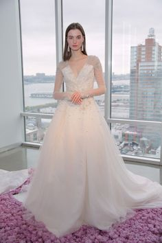 Beautifully embellished Pamella Roland gown: http://www.stylemepretty.com/2014/10/16/favorites-from-bridal-week-fall-2015/