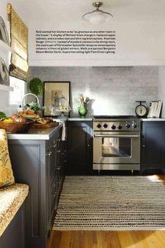 kilim rug + stone tile + dark grey cabinets