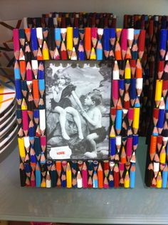 DIY Picture frame    This would look cool with only backs whites and grays!