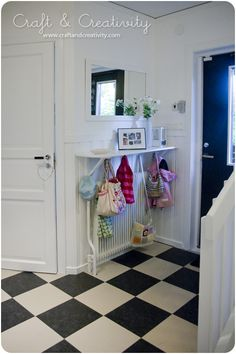 Love the hooks underneath the shelf!  Inexpensive and easy to do on your own! Great Idea!