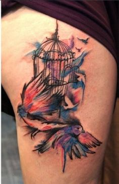 abstract bird and cage watercolor tattoo on thigh - feather