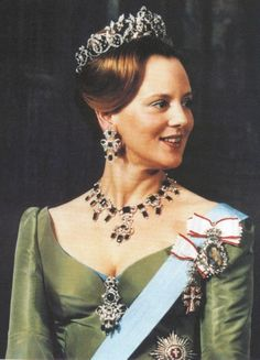 A young Queen Margrethe II of Denmark wearing the emerald parure from the Danish Crown Jewels.