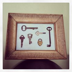 Part of my key collection displayed in an antique frame