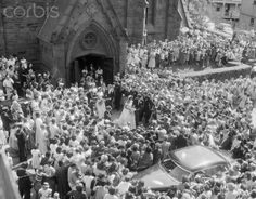 The crowd outside St. Mary's Church in Newport, Rhode Island, looking to get a glance at the wedding of Jack and Jackie Kennedy in 1953.