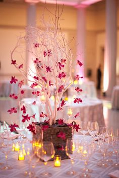 Flower garland hanging from 	 Manzanita tree (or one made from bare branches) as centerpiece.