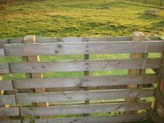~Pallets slipped over fence posts.  Simply Genius! - - Would work in the garden for trellises, too!