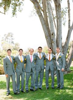 grey suits and colored ties