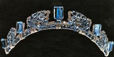 The Aquamarine Pineflower Tiara:  Cartier is responsible for this gem and it features aquamarines set in a pine cone motif interspersed with rectangular stones.  This piece originally belonged to the Queen Mother. It was an anniversary gift from her husband, King George VI.  Among her collection, this wasn't a real favorite. She didn't wear it often before gifting it to her granddaughter, Princess Anne.  Anne had the gem altered at some point; she shortened it to make it easier to wear.