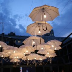 "From paisleytreepress.com ""Umbrella Lights"" great for an open air wedding"