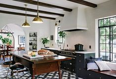 In a space like the kitchen—where there's so much going on—black paint can create a sleek, organized beauty.