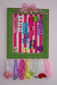 Homemade hair bow holder - painted picture frame decorated with rhinestone pins and earrings. Hooks were added to the bottom to store headbands.