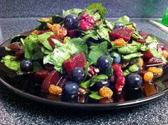 Vibrant Antioxidant Salad w/ Golden Raisins, Blueberries, Beets and Red Walnuts on Baby Spinach.
