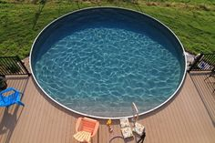 Above Ground Pool with half deck and steps in pool