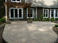 Elevated Tumbled 3 pc Olde World Cobble Concrete Paver Patio and Pergola with Dry Stack Stone Wrapped Column Bases