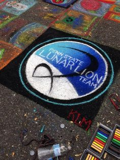 Twitter / KaraLMorgan: Played with chalk pastels all ...  |  Our Lunar Lion crew includes some chalk artists, too! Multitalented students at Penn State make us so proud. During the Arts Festival in State College and University Park, some Lunar Lions chalk painted the Penn State Lunar Lion Team logo. Looking good in blue and white!
