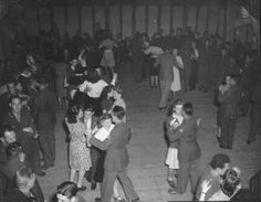 The enlisted men enjoy a dance with local English girls at the 381st Bomb Group.