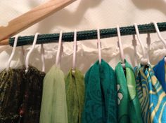 Scarf organization.  Wooden hanger with rod covered with shelf liner, plastic ball shower curtain hooks, add scarves, VOILA!  Now I can see which ones I have!!