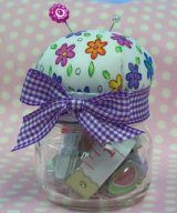 Fantastic ideas to reuse baby food jars: holding child-friendly snacks (raisins etc), using for single-serve portions of salad dressing etc. in lunchboxes, holding candles, gift jars (cover the top with some pretty fabric and fill the jar with candy, tea leaves, bath salts etc), pin cushion and sewing kit