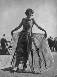 A model wearing a yellow organdie over gold evening gown during a fashion show held at Biltmore Beach in Rye, New York, 1920. #vintage #fashion #1920s #dress