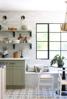 Modern Country Kitchen English Tudor Kitchen Open Shelving Patterned Tile Breakfast Nook Woven Dining Chairs Bronze and Black Sconces Green Cabinets White Subway Tile Bronze Pendant Light Dining Room Shelf Styling