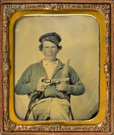 ca. 1861, Ambrotype portrait of Confederate Private Japhet Collins, brandishing a pistol and a knife. Southern Methodist Central University Libraries.