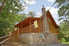 A Stones Throw cabin rental in Pigeon Forge, TN. This extremely spacious, luxury cabin is beautifully decorated and offers everything you could need for a fantastic vacation! Each of the 2 master suites offers a King size bed and a lovely stacked stone Jacuzzi tub.  You can enjoy playing with the WII video game, pool table, and dart board in the game room. If you prefer to relax, the stone fireplace is ideal, or you can head outdoors and enjoy the private hot tub on the deck.