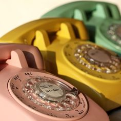 Vintage telephones in pink, yellow & mint