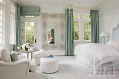 An antique folk-art mirror was the starting point for the master bedroom's decor.