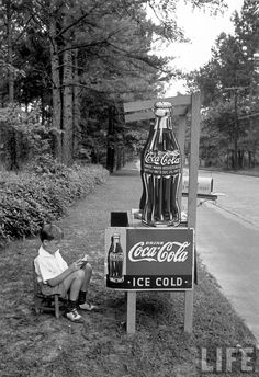 Boy selling Coca Cola from roadside stand. Atlanta, 1936. By Alfred Eisenstaedt