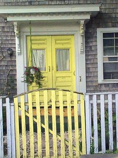 Fence and yellow door