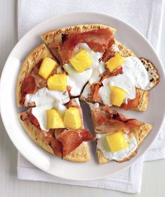 Ham and Pineapple Pita Pizzas  http://www.realsimple.com/food-recipes/browse-all-recipes/ham-pineapple-pita-pizzas-00000000018847/