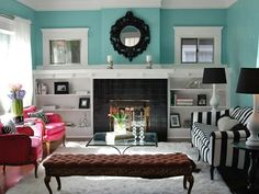 Perfect wall colour. Gorgeous black mirror. Black and white striped couch. Pink armchairs. Awesome lamps. Yep.