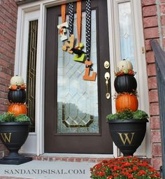 Hang wooden letters from ribbons that spell Fall on front door