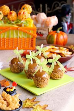 Butterfinger Caramel Apples: 5 Granny Smith Apples, 5 wooden dowels or popsicle sticks, 3 (2.1 ounce) Butterfinger candy bars, 14-ounce bag caramels, unwrapped, 2 tablespoons half and half, 1 teaspoon light corn syrup, Pinch of salt.