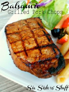 Balsamic Grilled Pork Chops- these are seriously the juiciest and most flavorful pork chops I have ever had! SixSistersStuff.com #pork #grilling