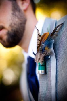 Boutonniere's that the guys will wear in the wedding (with flowers instead of feathers) Shot Gun Shell Boutonniere, Shotgun Shell Boutonniere, Peacock Boutonniere