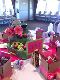 "Moving Party for a sweet friend...  Luggage style boxes as centerpieces, florals nested inside with mini cupcakes on lower boxes, Leopard print clothespin with ""Friendship"" quote...  Favors were small 4 x4 boxes with candy bar, wrapper was a poem on Friend Moving Survival Kit, Luggage tag with Friend's new address and tissues..."