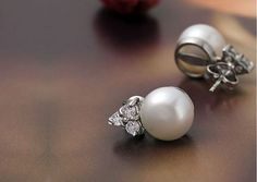 Check out this item in my Etsy shop https://www.etsy.com/listing/208791627/fresh-water-white-pearl-stud-earrings
