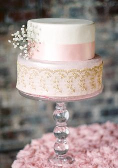 Pink and gold wedding cake.