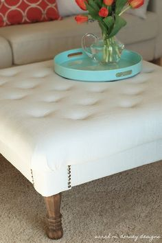 DIY tufted ottoman from scratch (I saw those legs at Home Depot just yesterday!) Great project.