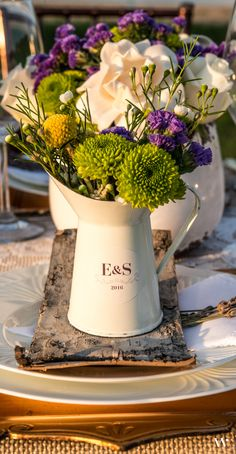 Design your own custom rustic centerpieces with some wild blooms and our striking French Provencal Style Enamel Pitchers: http://www.weddingstar.com/product/french-provencal-style-enamel-pitcher